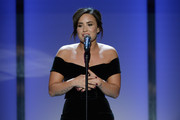 Demi Lovato wore red nail polish for a pop of color to her black dress at the 2016 Glamour Women of the Year show.