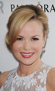 Amanda Holden topped off her feminine look with glossy pink lips.