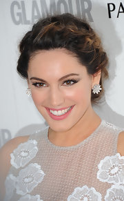 Slightly mussed texture kept Kelly Brook's romantic braided updo soft and unfussy.