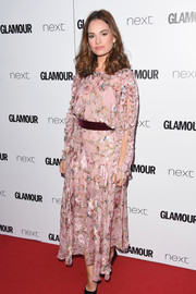 Lily James looked ultra sweet in a vintage pink floral frock with ruffle detailing at the 2017 Glamour Women of the Year Awards.