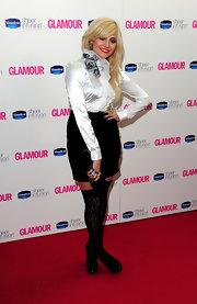 Pixie paired her black skirt with a white blouse while hitting the Glamour women of the year awards.