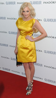 Fearne popped on the red carpet in a bold yellow cocktail dress and playful patchwork heels.