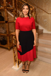 America Ferrera kept it simple in a red knit top at the Glamour x Tory Burch Women to Watch lunch.