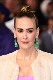 Sarah Paulson teamed her updo with a pair of green chandelier earrings by Irene Neuwirth.