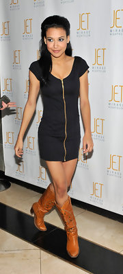 Naya Rivera dressed down her sultry LBD with a pair of classic tan cowboy boots.