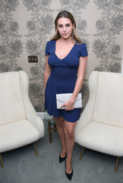 Sophia Rose Stallone cut a shapely silhouette in a blue mini dress with a smocked waist during Glenda Bailey's book launch.