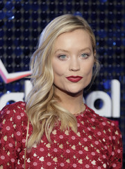 Laura Whitmore swiped on some matte berry lipstick to match her frock.