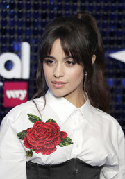 Camila Cabello wore her hair in a high ponytail with curtain bangs at the Global Awards 2020.