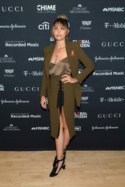 Paris Jackson styled her look with black ankle-tie pumps that echoed the ribbon detail on her skirt.