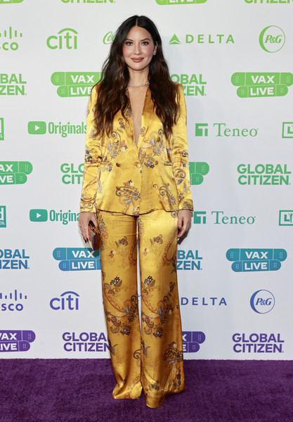 Olivia Munn went for pajama glamour in a marigold satin pantsuit by L'Agence at the Global Citizen VAX LIVE.
