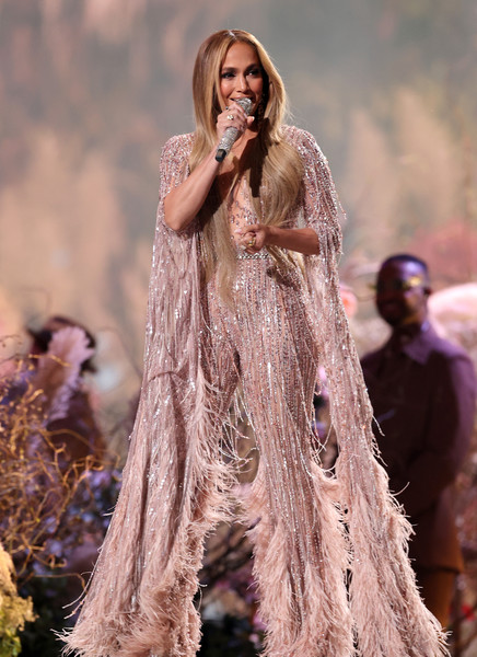 Jennifer Lopez performed at the Global Citizen VAX LIVE wearing a feathered and beaded blush jumpsuit by Zuhair Murad Couture.