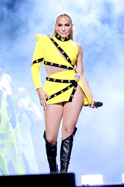 Jennifer Lopez looked fierce in a studded yellow and black cutout dress by Fausto Fuglisi for Roberto Cavalli at the Global Citizen VAX LIVE.