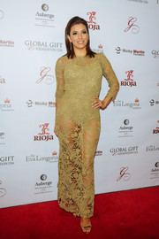 Eva Longoria worked a super-sultry look in this see-through olive-green lace gown by Maria Lucia Hohan at the Global Gift Foundation dinner.