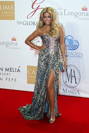 Silvie Van Der Vaart posed on the red carpet for the Global Gift Gala in a pair of fabulous blinged-out evening sandals.