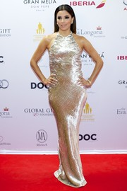 Eva Longoria totally dazzled in a gold velvet gown by Reem Acra during the Global Gift Gala.