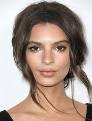 Emily Ratajkowski topped off her look with a messy-sexy beehive-inspired updo when she attended the Global Green USA pre-Oscar party.
