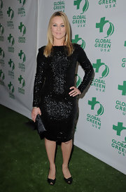 Elisabeth Rohm balanced her fitted sequined dress with classic black satin peep toes.