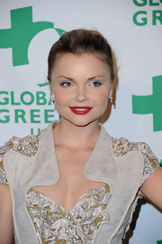 Izabella Miko attended the 9th Annual Global Green USA pre-Oscar party wearing a bold matte red lipstick.