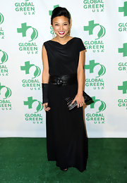 Jeannie Mai attended Global Green USA's pre-Oscar party looking edgy in an asymmetrical-sleeve black evening dress cinched with a wide leather belt.