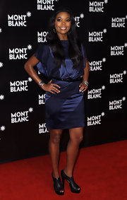 Gabrielle Union was fashion forward in a pair of black cut out ankle boots.