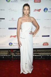 Gigi Hadid looked impeccable in a strapless white gown by Hilfiger Collection at the Global Lyme Alliance Gala.