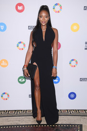 Naomi Campbell looked va-va-voom, as always, in a black Brandon Maxwell halter gown with side cutouts and an up-to-there slit at the Global Goals Awards 2017.