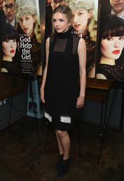 Hannah Murray opted for a pair of black ankle boots to complete her outfit.