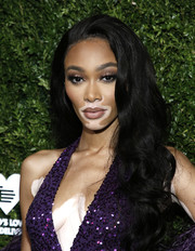 Winnie Harlow accentuated her eyes with smoky makeup.