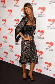 Iman made a very sophisticated choice with this black lace skirt suit by Michael Kors when she attended the Golden Heart Awards.