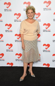 Bette Midler paired an embellished silver skirt with her V-neck sweater for a more sophisticated finish at the Golden Heart Awards.