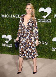 Kate Hudson hovered between sweet and sexy in a plunging floral dress by Michael Kors at the God's Love We Deliver, Golden Heart Awards.