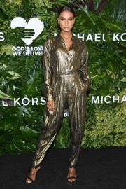 Jasmine Tookes amped up the shimmer with a pair of gold lamé trousers.