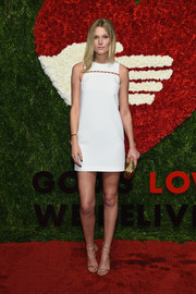Toni Garrn was all legs in a sleeveless white mini dress with a studded yoke at the God's Love We Deliver, Golden Heart Awards.