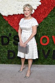 Bette Midler added an extra dose of shine via a metallic silver clutch.
