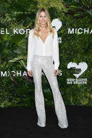 Jessica Hart looked simply stylish in a floaty white button-down by Michael Kors at the Golden Heart Awards.