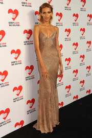 Anja Rubik showed off her supermodel figure in a slinky gold Jason Wu evening dress during the Golden Heart Awards.