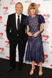 Anna Wintour looked very dressy, as always, in a blue Michael Kors cocktail dress with flutter sleeves when she attended the Golden Heart Awards.
