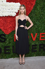 Nicola Peltz looked sexy-trendy in a black cutout halter dress by Michael Kors during the Golden Heart Awards.