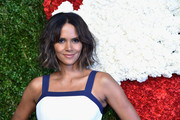 Halle Berry wore her hair short with a center part and blonde-streaked waves at the Golden Heart Awards.