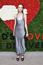 Daria Strokous contrasted her sexy dress with clunky black platform sandals.