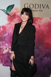 Daisy Lowe teamed a black box bag with a skirt suit for the Godiva Masterpiece Banquet.