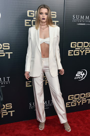Abbey Lee caught eyes in a white Helmut Lang pantsuit teamed with a bra top at the New York premiere of 'Gods of Egypt.'