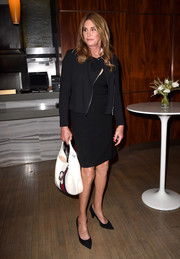 Caitlyn Jenner styled her look with a white and red leather hobo bag.