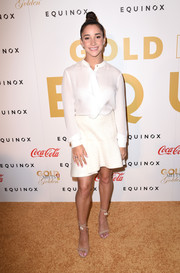 Aly Raisman kept it demure in a long-sleeve white ruffle blouse at the Gold Meets Golden event.