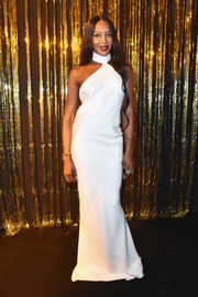 Naomi Campbell was minimalist-chic in a white halter gown by Brandon Maxwell at the Gold Obsession Party.