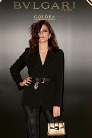 Eleonora Carisi accessorized with a brown leather belt to give her jacket some shape.