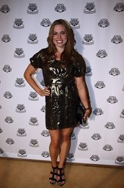 Natalie Coughlin arrived at the 2009 Golden Goggles Awards in a short leather dress.