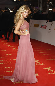 Sylvie van der Vaart looked like a Barbie doll in a couture pink beaded cutout dress by Escada at the Goldene Kamera Awards.