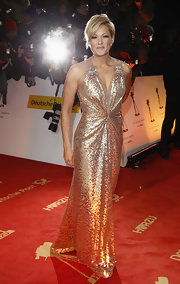 Helene Fischer lit up the 2012 Goldene Kamera red carpet with her ultra-glam sequined gold halter gown.
