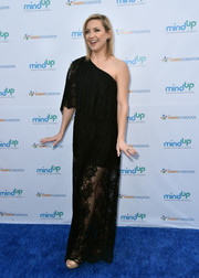 Kate Hudson kept it subdued yet sweet in a loose black one-shoulder maxi dress at the Love In For Kids event.